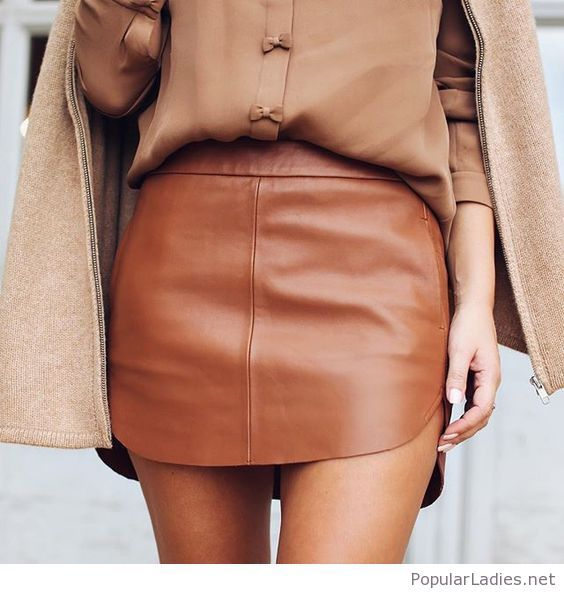 Awesome brown leather mini skirt, love the bows