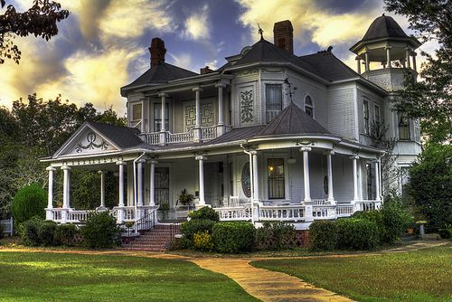 Great front porch. Love the open tower too.