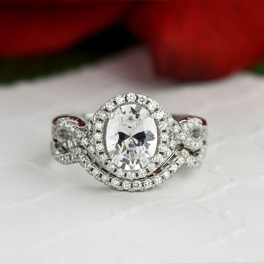 Modern Halo Engagement Ring With 2 Wedding Bands Festooning The