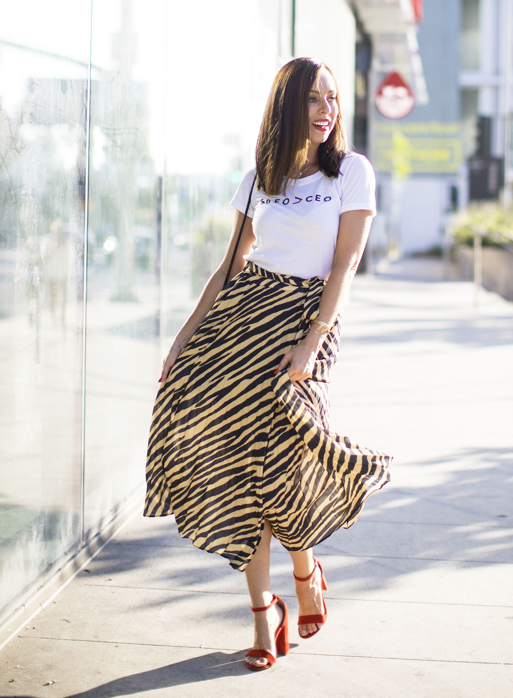 5f29d7587812 Sydne Style shows how to wear graphic tees with zebra print skirt #zebra # skirts #tees #tshirt #graphictee