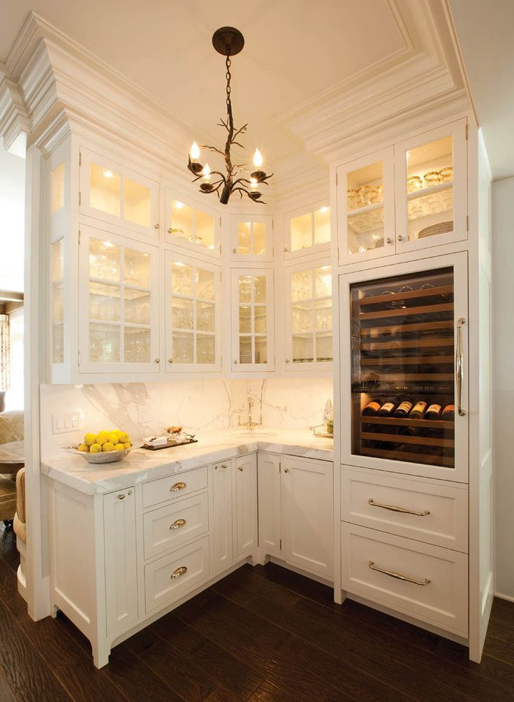 LUCY WILLIAMS INTERIORS BLOG- love the molding, glass windows for the barware and the wine fridge at eye height.