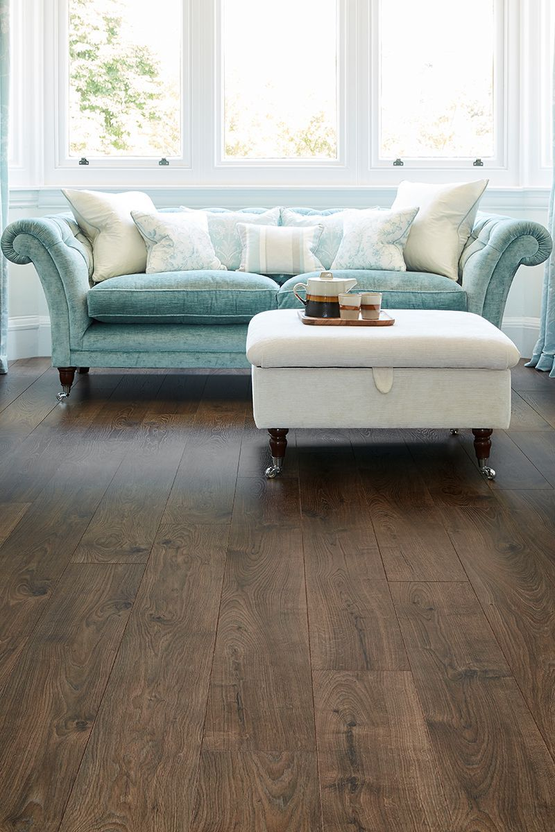 With An Laidback Vintage Look Vantage Wood 12mm Laminate Flooring Everest Oak Comes Dark Wood Floors Living Room Wooden Floors Living Room Luxury Living Room