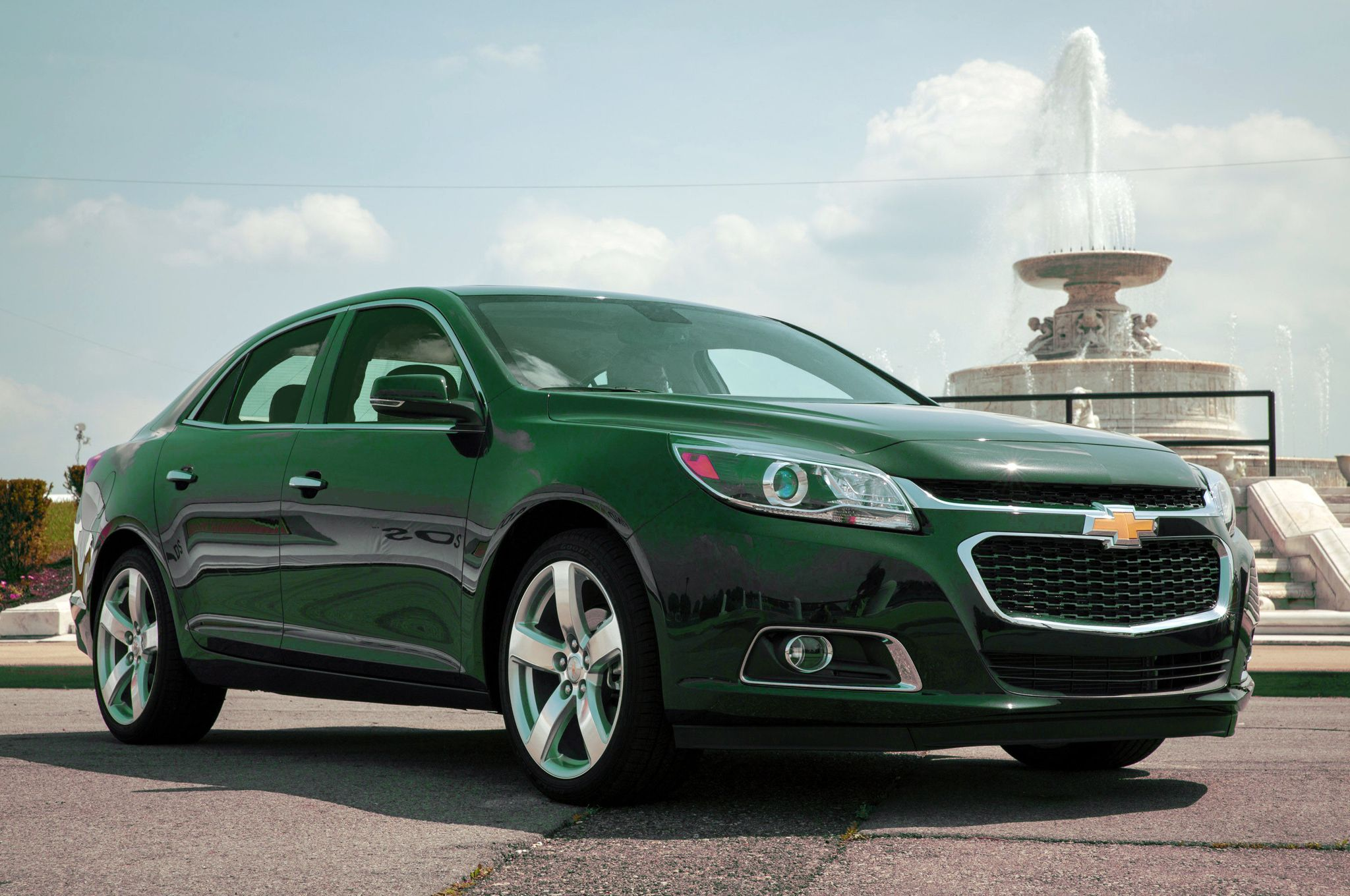 Beautiful Rain Forest Green Chevrolet Malibu In Front Of A
