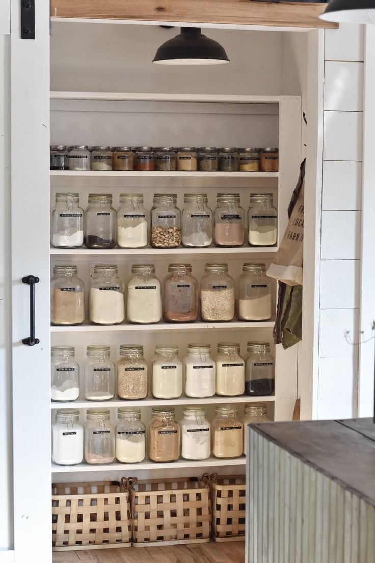 #pantryorganization Walk in kitchen pantry organized with jars that holds spices and herbs.  #pantry  #pantryorganization  #pantrystaples  #kitchenpantryideas  #rockyhedgefarm #Pantry #Essentials #for  Pantry Essentials for a Well Stocked Kitchen - Rocky Hedge Farm