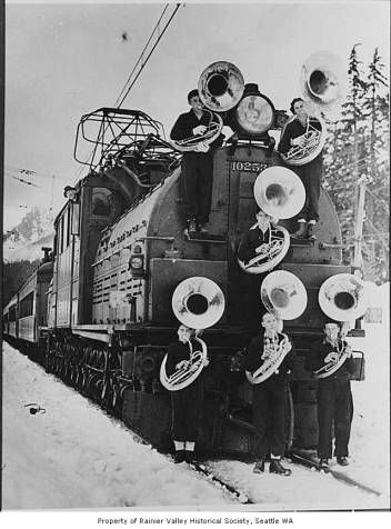 Members of Franklin High School band with train, Snoqualmie Pass, January 1938 :: Rainier Valley Historical Society