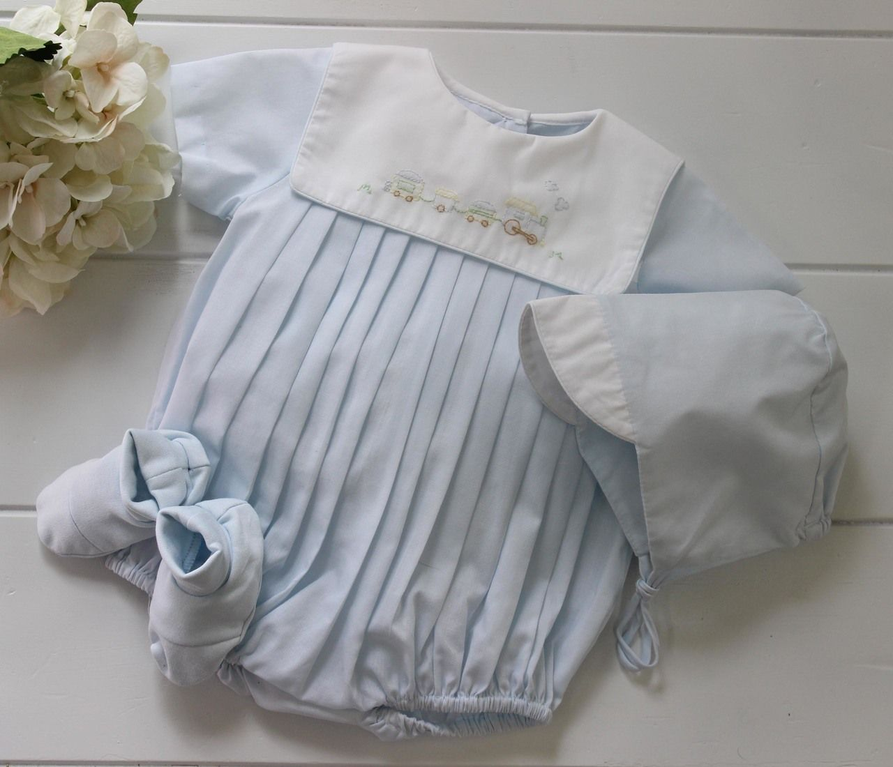 a2c92bb4fb5fd Beautiful baby boys take home bubble outfit with embroidered train collar.  Shop traditional baby boys