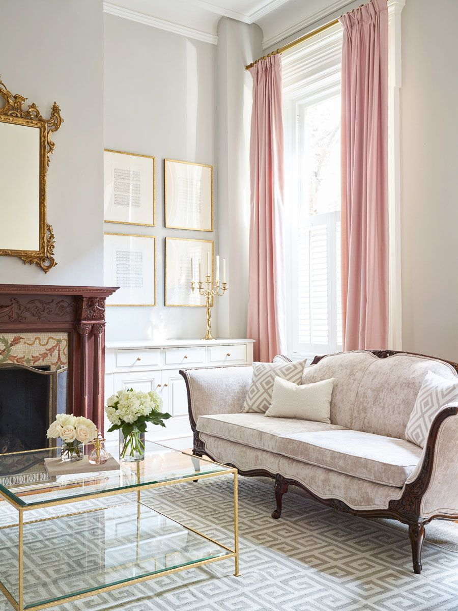 Tall soft pink curtains in this parlor. Greek key layered rugs and ...