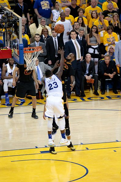 LeBron James of the Cleveland Cavaliers goes to the basket against Draymond  Green of the Golden State Warriors in Game Seven of the 2016 NBA Finals. b130c18d9