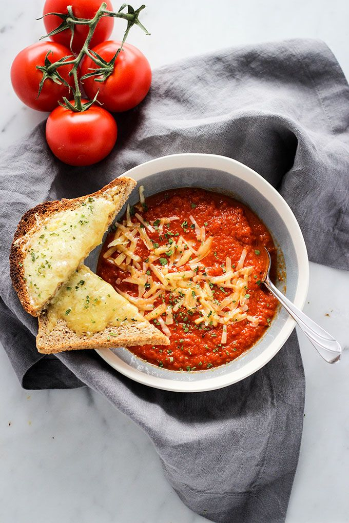 Cook up this roasted red pepper tomato soup and serve it alongside cheesy toast and fresh herbs.