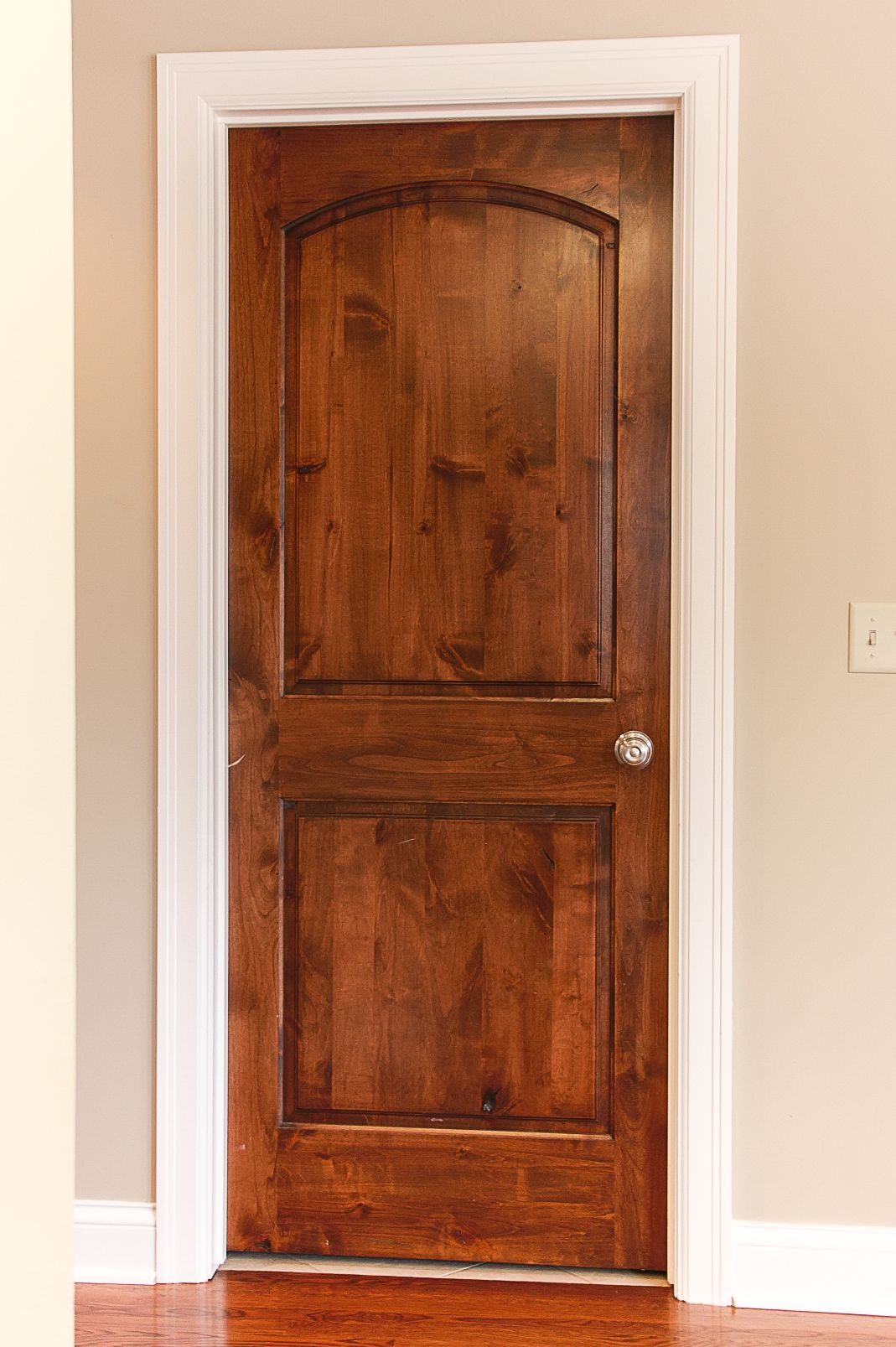 White trim and Wood doors  Custom stained Alder Doors