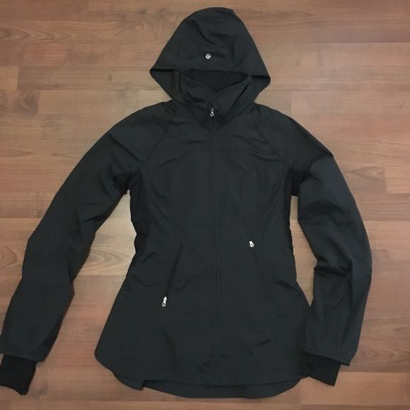 """Lululemon Black Water Resistant To and From Jacket Excellent condition size 6 """"to and from"""" water/rain resistant jacket with a convertible hood that you can wear out or tucked in to a zippered pouch around the neck of the jacket. Zippered pockets on the mid section and thumb holes on sleeves. Very figure flattering with a peplum on the bottom of the back of the jacket! Only worn a couple times lululemon athletica Jackets & Coats"""
