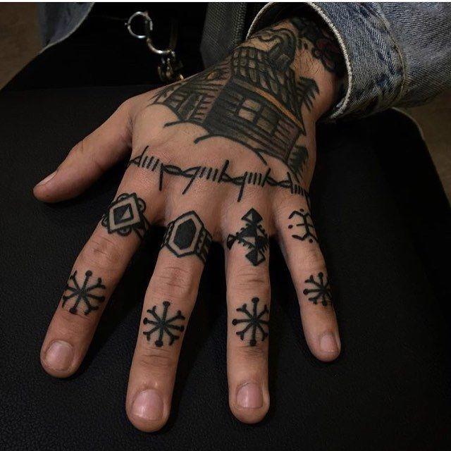 Black Snowflake Tattoos On Left Hand S Fingers Hand Tattoos Hand Tattoos For Guys Finger Tattoos