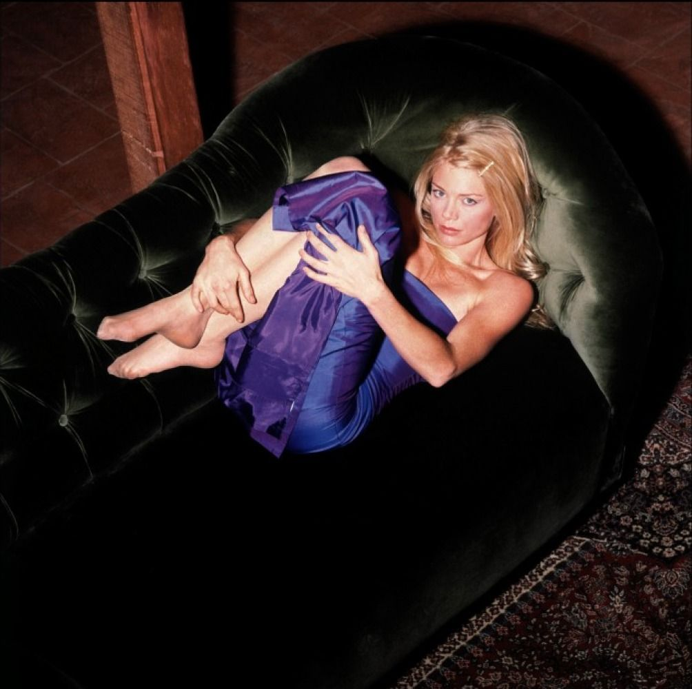 Here she is in a more feminine, demure pose on a couch. And yes, she's in her nude nylons - the lovely Peta Wilson