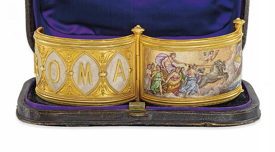 A 19TH CENTURY MICROMOSAIC BANGLE The broad hinged bangle with fine bead and ropework decoration, the front set with a rectangular micromosaic panel depicting Aurora, the goddess of the dawn, flying before the chariot of Apollo, with the clouds of night rolling away before them, the reverse with applied letters spelling ROMA, each character raised on a navette shaped cream micromosaic ground, circa 1870, inner diameter 5.9cm, original fitted case
