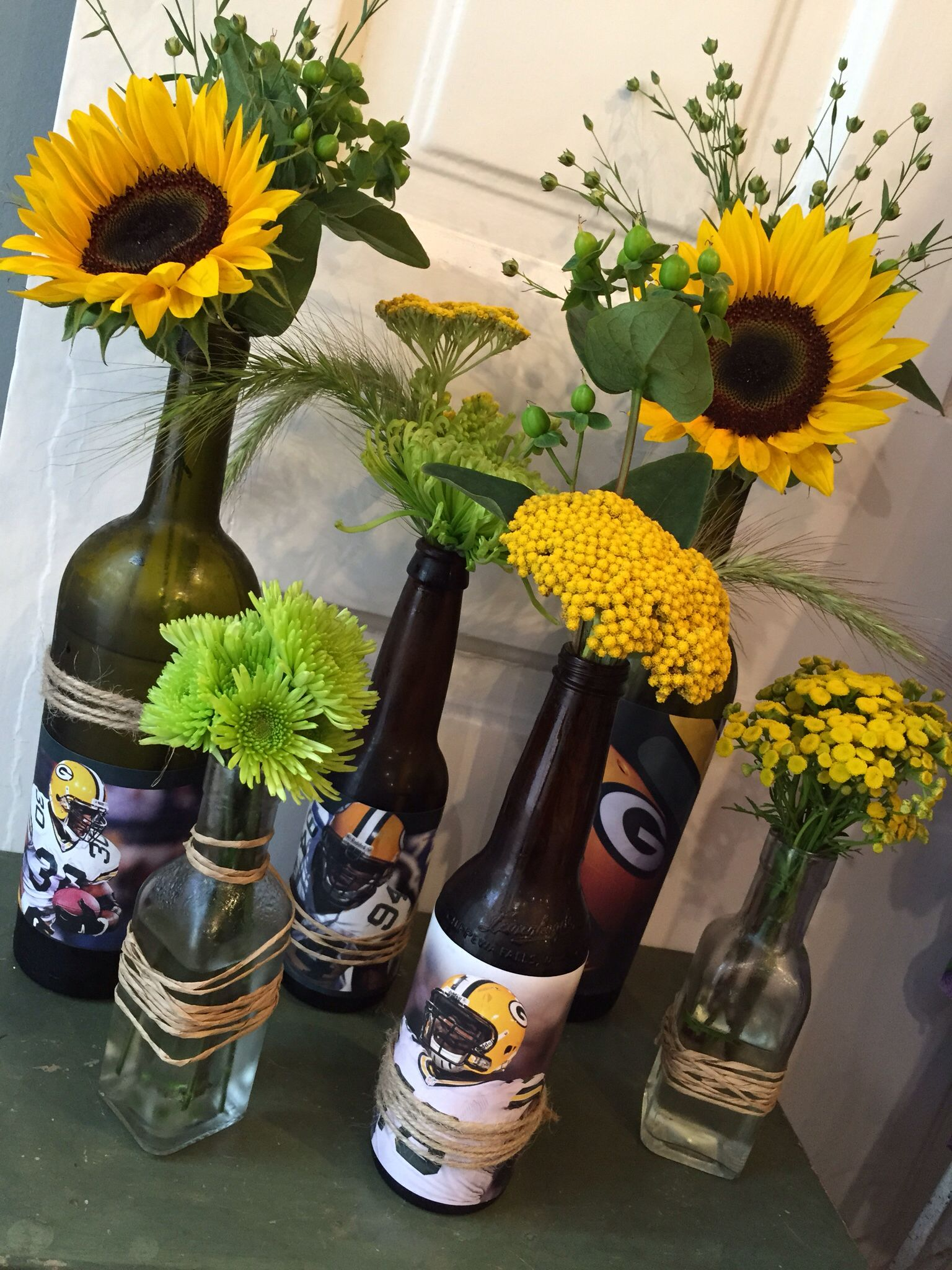 Packer football centerpiece in upcycled beer and wine bottles
