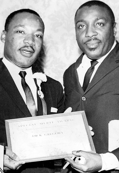 Writer and social activist Dick Gregory and Civil Rights leader the Reverend Dr Martin Luther King Jr holding the Merit Award of the Southern.