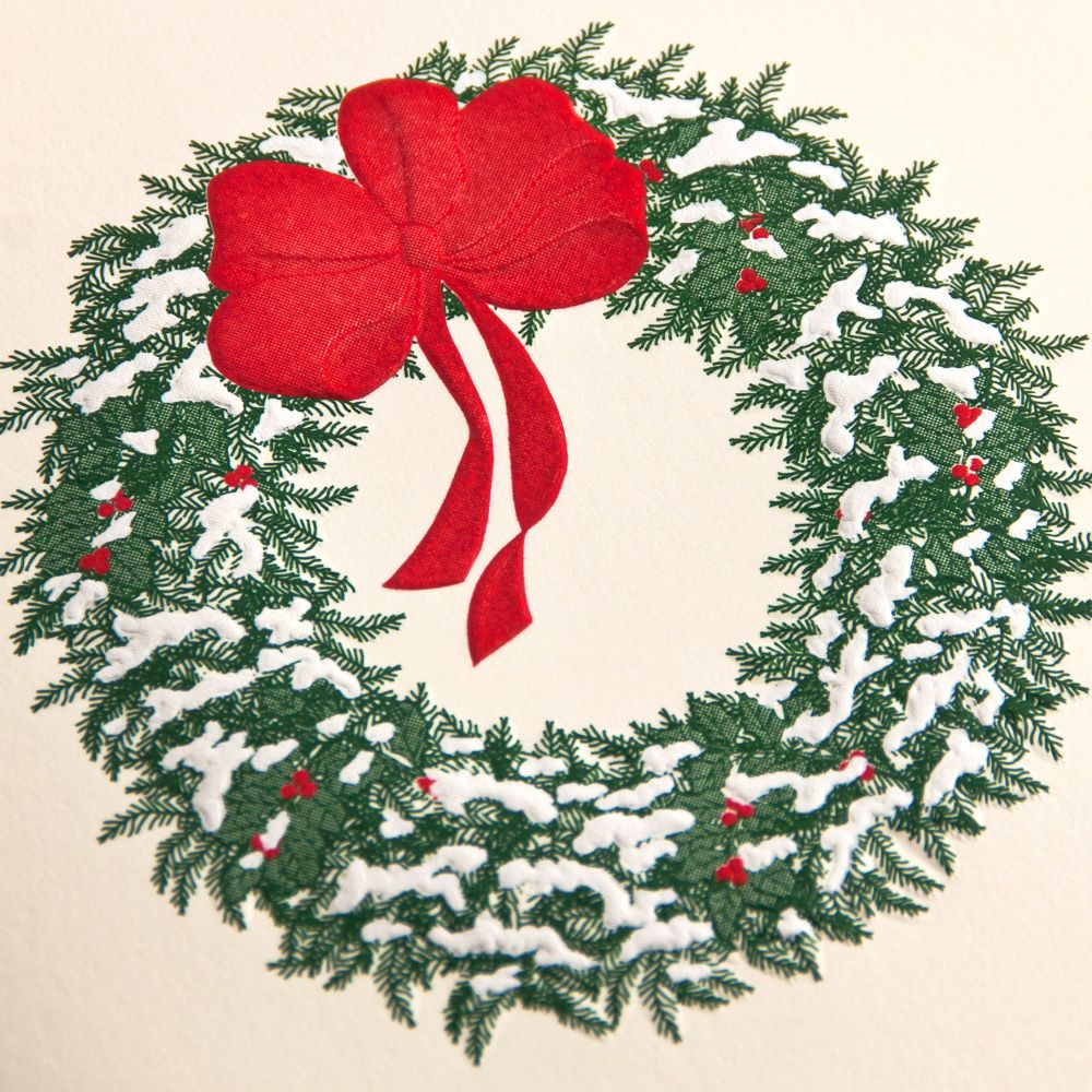 Engraved Snowy Wreath Holiday Greeting Card: A symbol of warm welcome, a wreath is an especially splendid display during the holiday season, when friends and family arrive at your doorstep bringing good cheer and even better sugary confections.