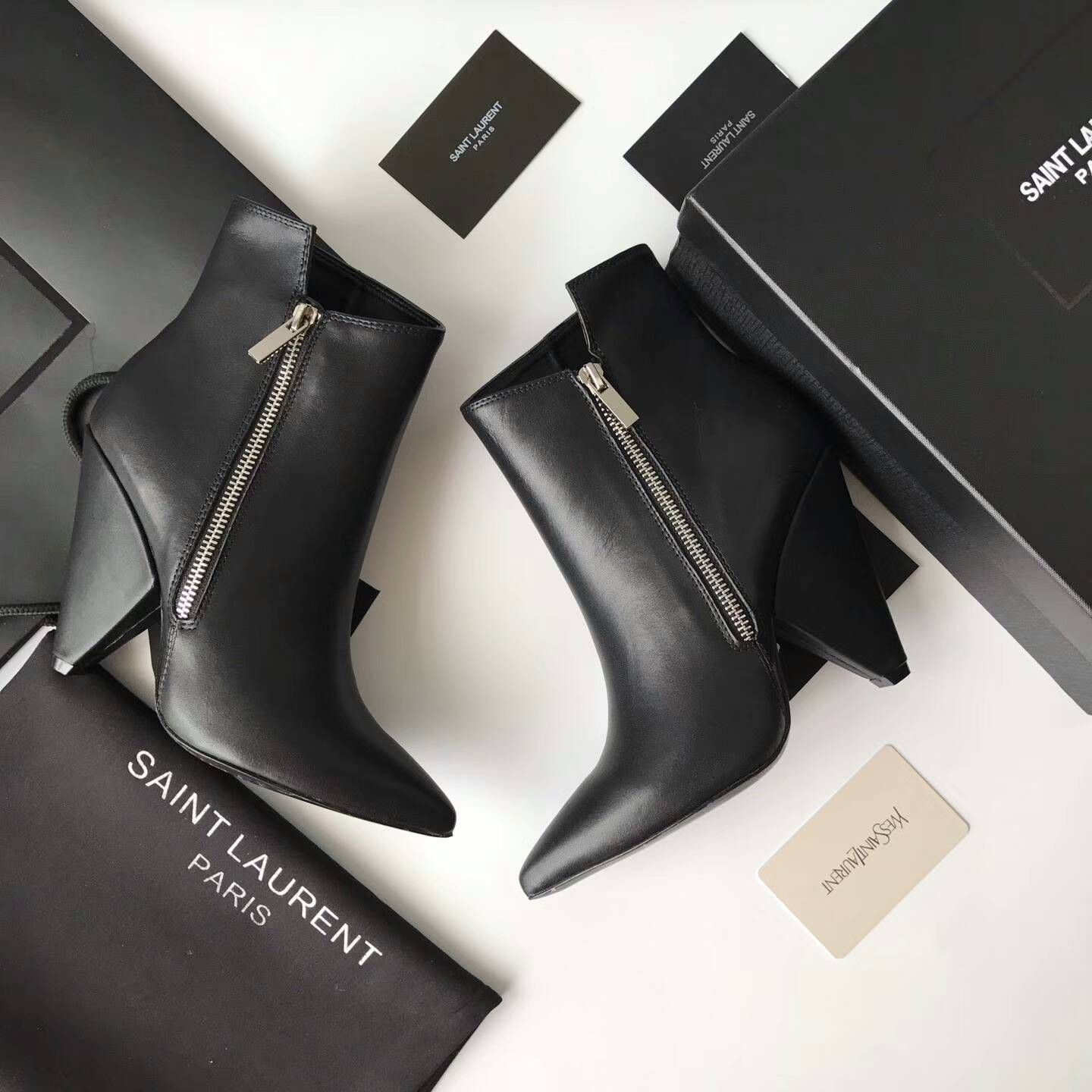 650e215a34e 2017 New Saint Laurent Niki Asymmetrical Ankle Boot in black Leather ...
