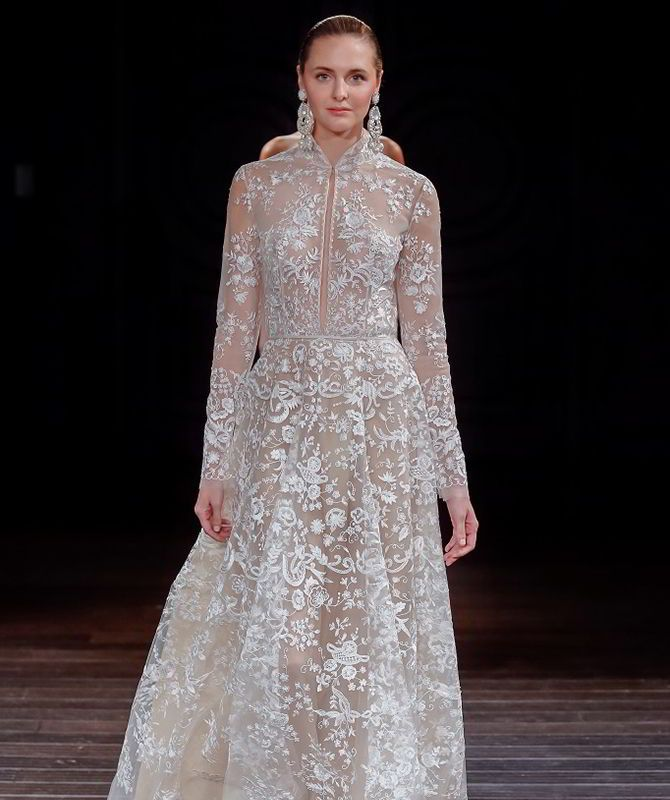 Naeem Khan Spring 2017 bridal collection features delicate lace, silk organza, chiffon, tulle, floral applique, silk mikado, petal, intricate beading, floral embellishments, and silk ribbon embroidery.