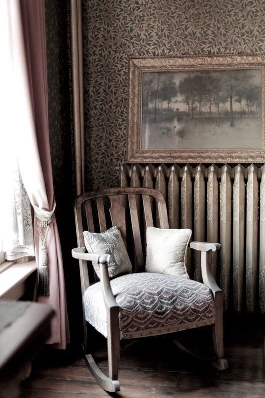 Vintage room with a rocking chair in taupe and beige