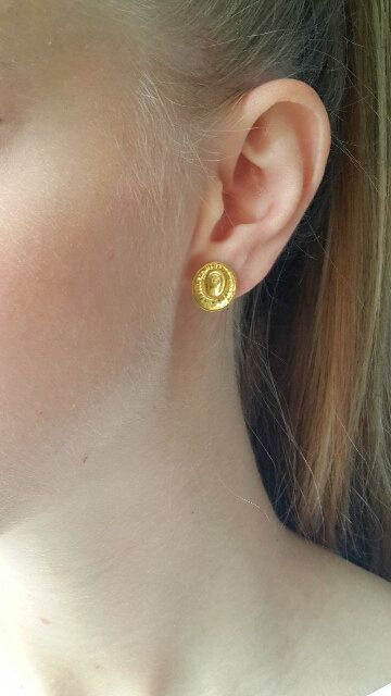 22k and 18k yellow gold earrings. These beautiful designer oval-shaped yellow gold earrings are handmade using the ancient repousee technique. The earrings are finely handmade and impressive. Approximate width 0.43 x 0.51 inches (11 X 13mm) No molds or forms are used, hence each piece is