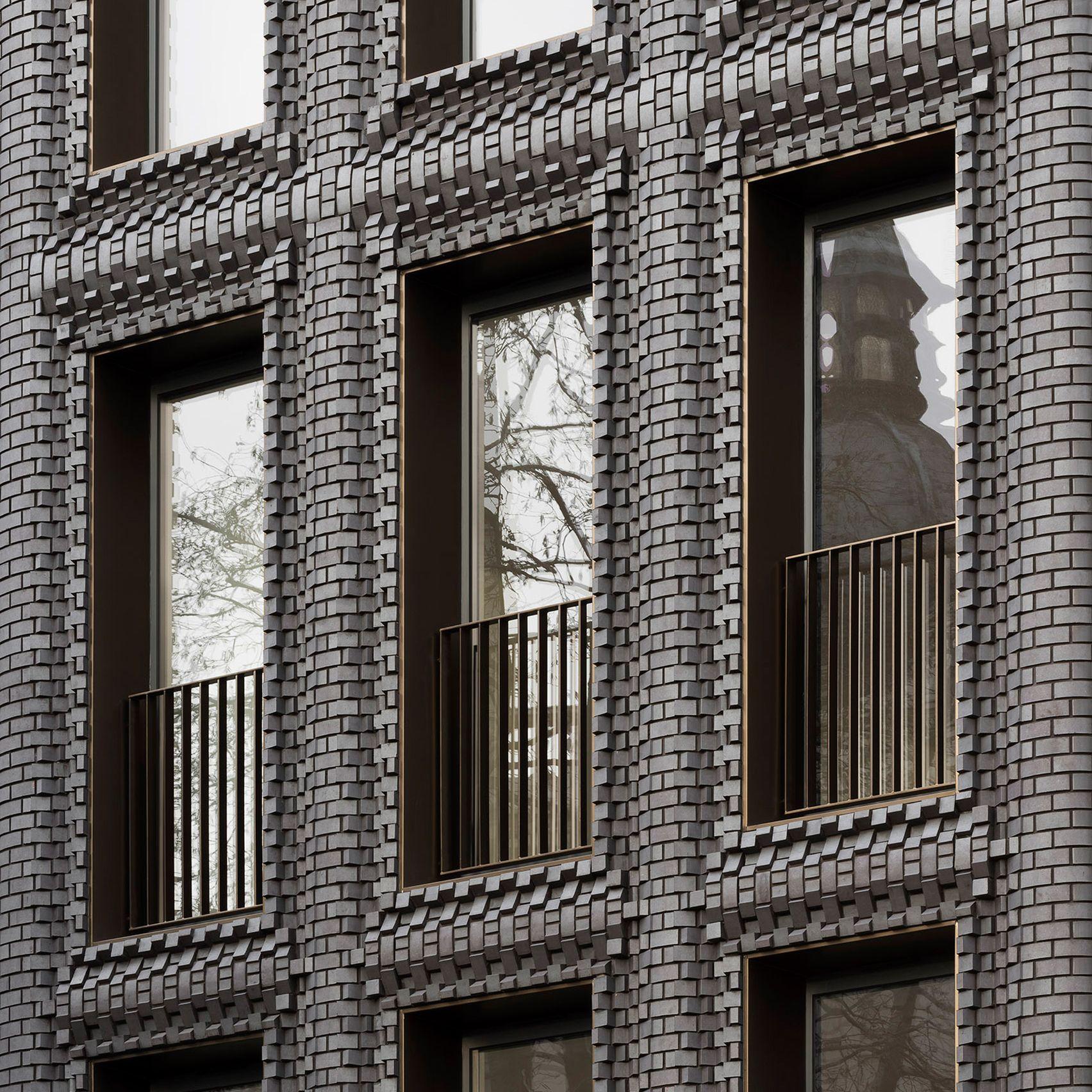 Bureau De Change Inserts Textured Brick Building Into