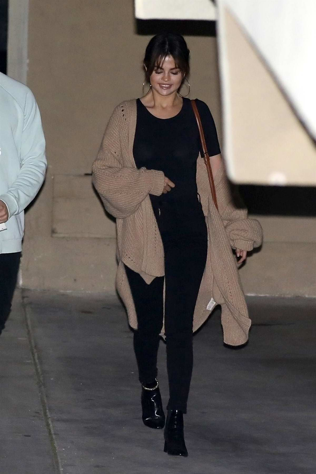 dd252c3dfbb7 Selena Gomez spotted in a brown knit cardigan over a black top and jeans as  she leaves church service in Los Angeles