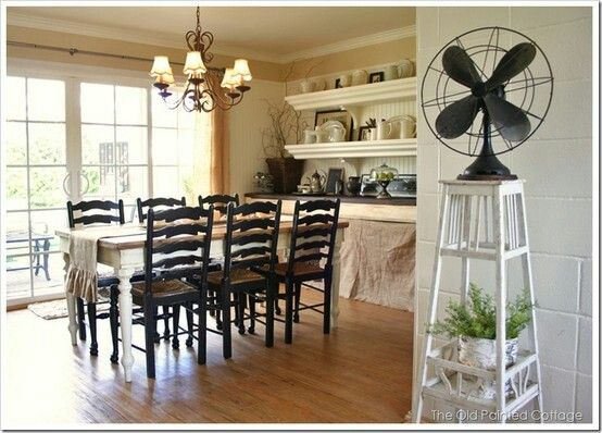 Black chairs, white farm table