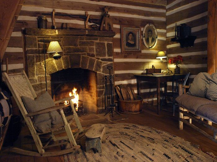 A very nice fireplace in an obviously older log cabin.. Most log ...
