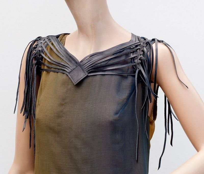 Fringe leather shrug Shredded black leather. $75.00, via Etsy.