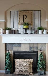 Ideas for covering up the built in TV nook above the fireplace