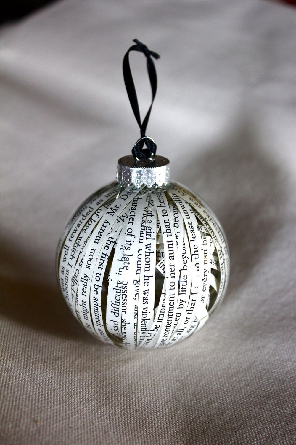 clear plastic ornament filled with strips of paper from a