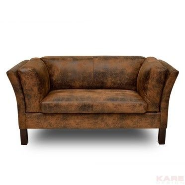 A Charming Vintage Look Two Seater The Striking Features Of This Elegant Sofa