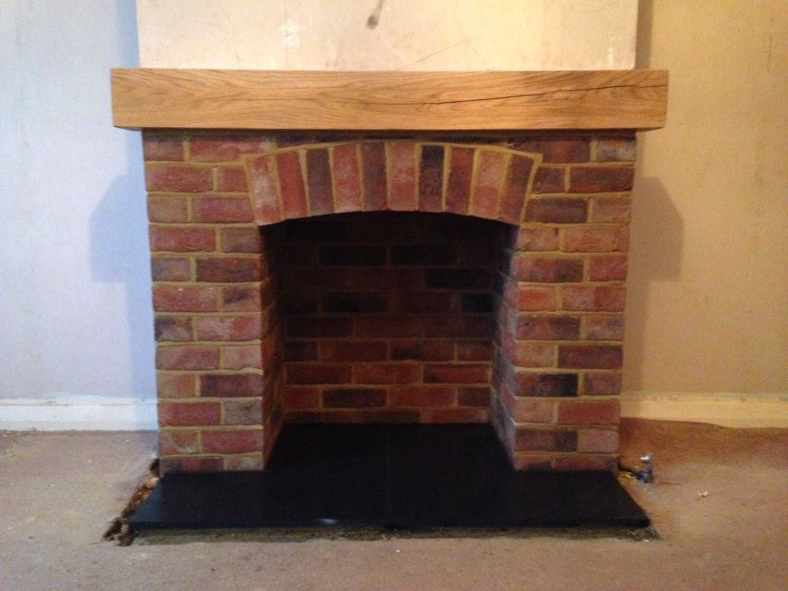 Brick fireplace with oak mantel stuff to buy pinterest oak mantel brick fireplace and mantels - Brick fireplace surrounds ideas ...