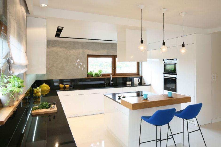 Przestronna Kuchnie Zdominowala Biel Jej Nowoczesny Charakter Podkreslaja Betonowe Dekoracje Scian Ulokowana Pod Kitchen Style Modern Kitchen Kitchen Design