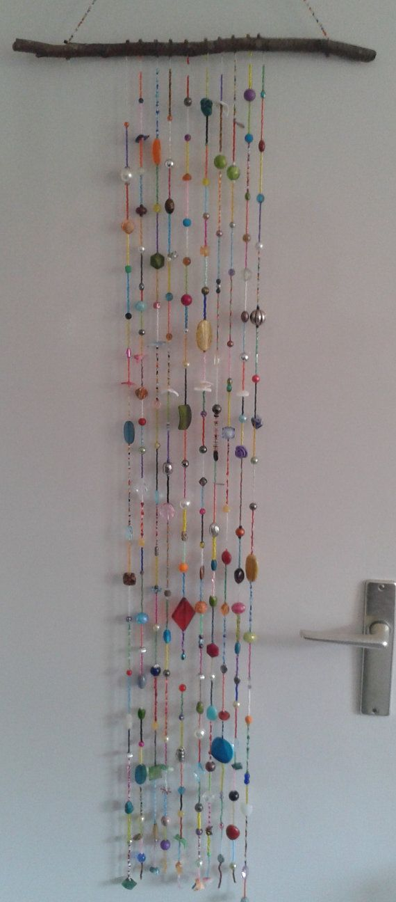Colorful boho wall hanging with many beads in a great variety of shapes and colors