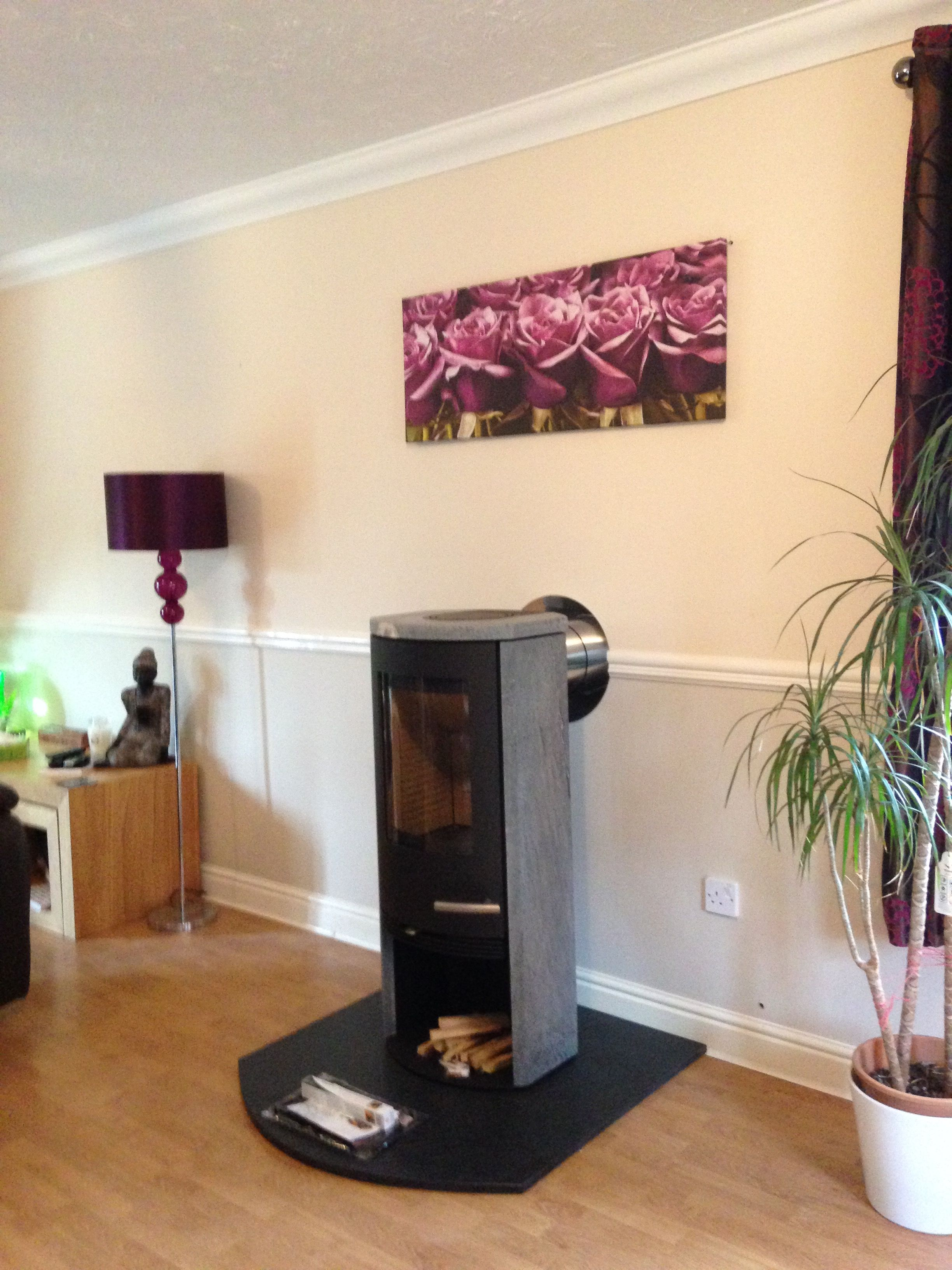 Termatech TT20S (Soapstone) stove, sitting on a honed black granite hearth  in a