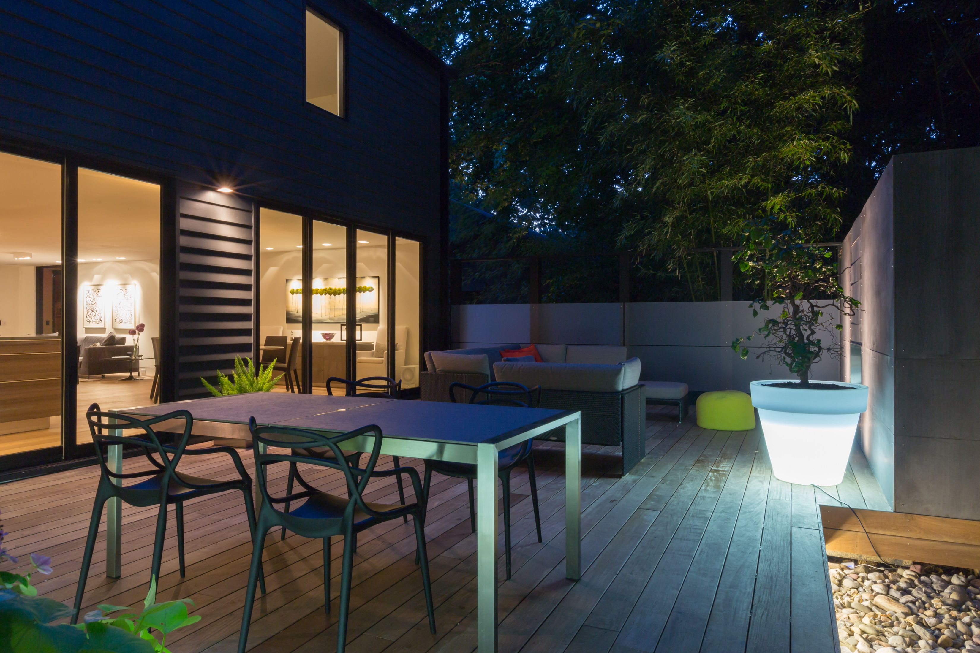 Modern lounge Ipe deck with large glowing planters illuminated