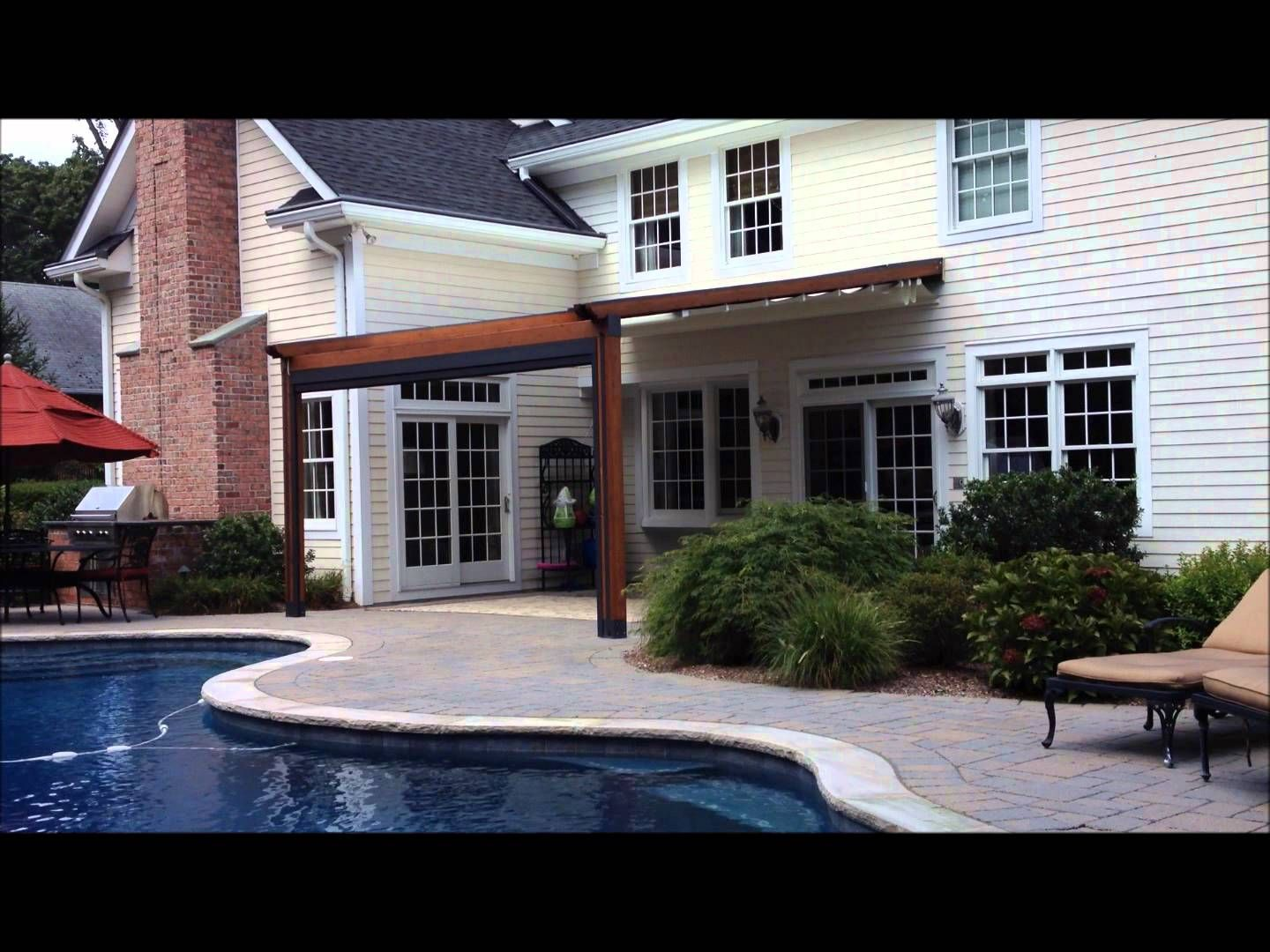The Gennius A Waterproof Retractable Awning By Durasol Awnings Was Selected This Homeowner For Aesthetics And Function With Solar Screen Drop Shade