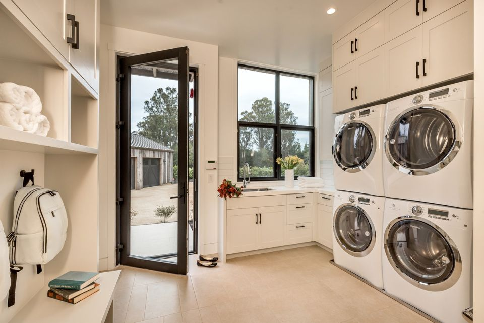 Clean White Mud Room With Double Washer And Dryer Clarum Homes