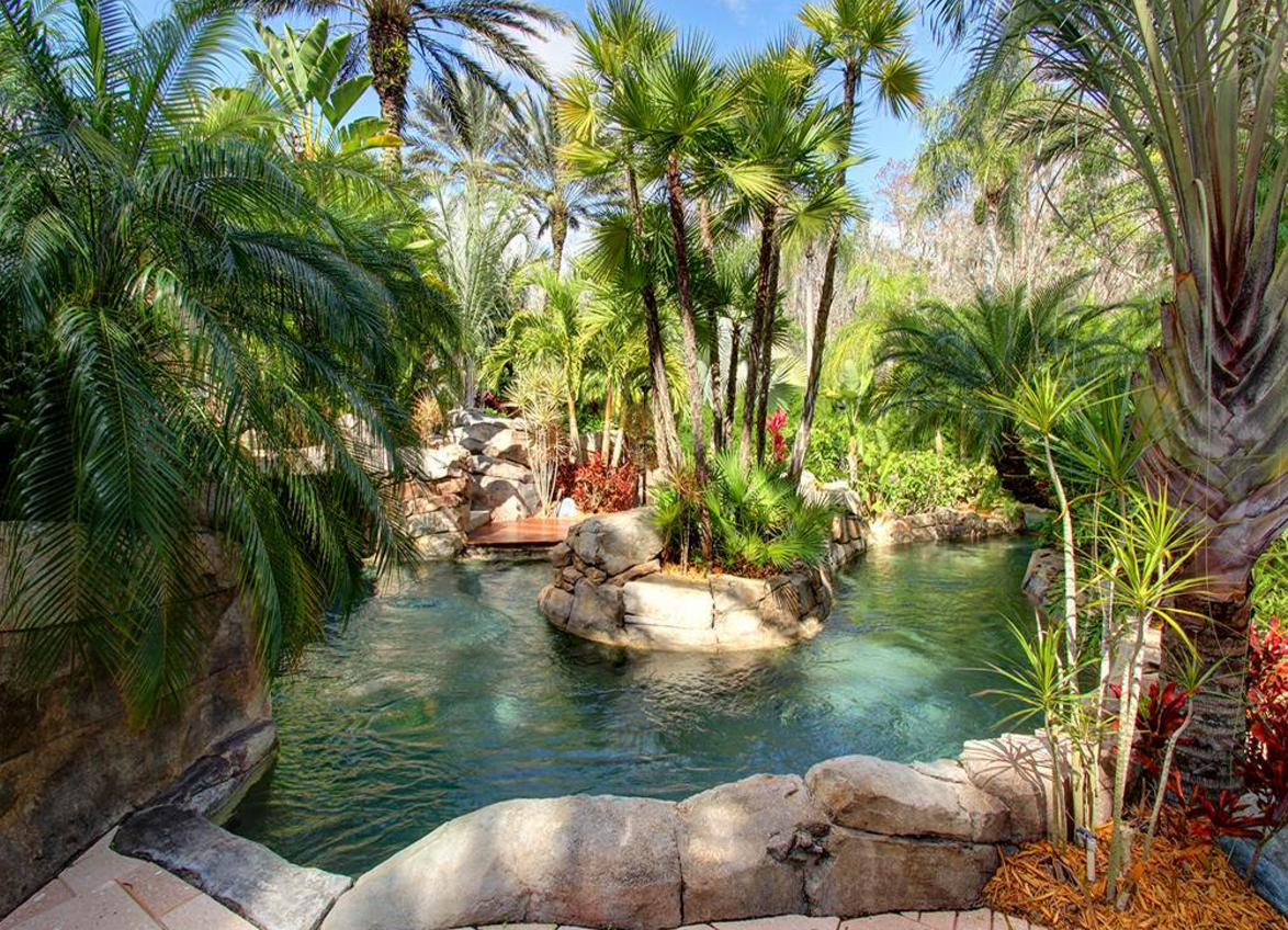 Themed Home Decor Tropical Themed Pool Tropical Themed Lazy River Tropical Backyard Pools Backyard Lazy River Pool Pool Landscaping Backyard Lazy River
