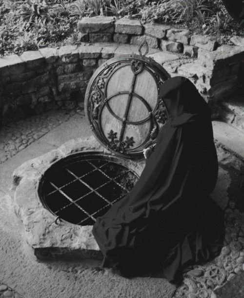The Chalice Well in Glastonbury, England. (Just the well, not the cloaked figure.)