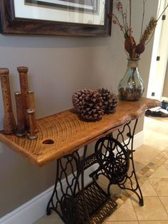 Hallway table made with Antique Singer Sewing table base and reclaimed Barn Wood.