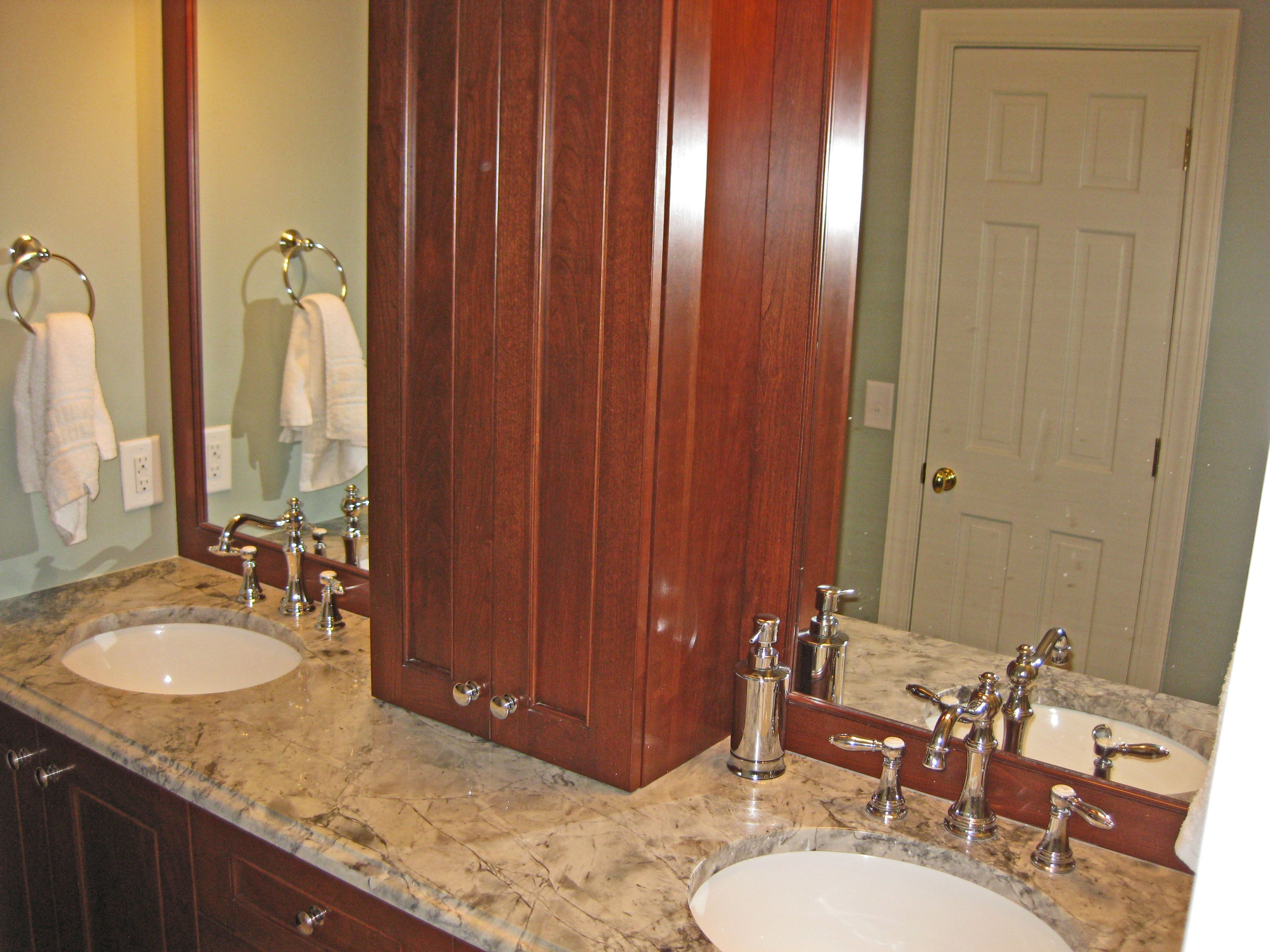 Master bathroom cabinetry. Cabinets are stained cherry. Countertops ...