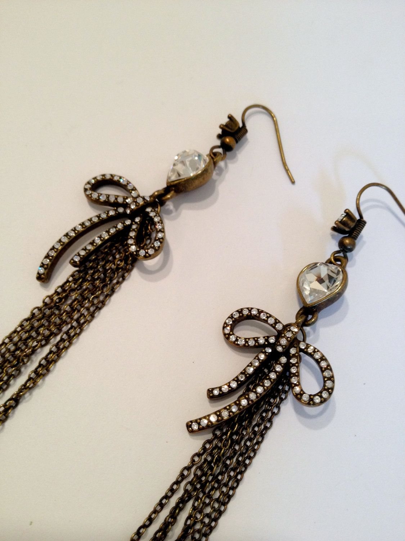 Long Pave Bow and Chain Long Dangle Earrings via Etsy.