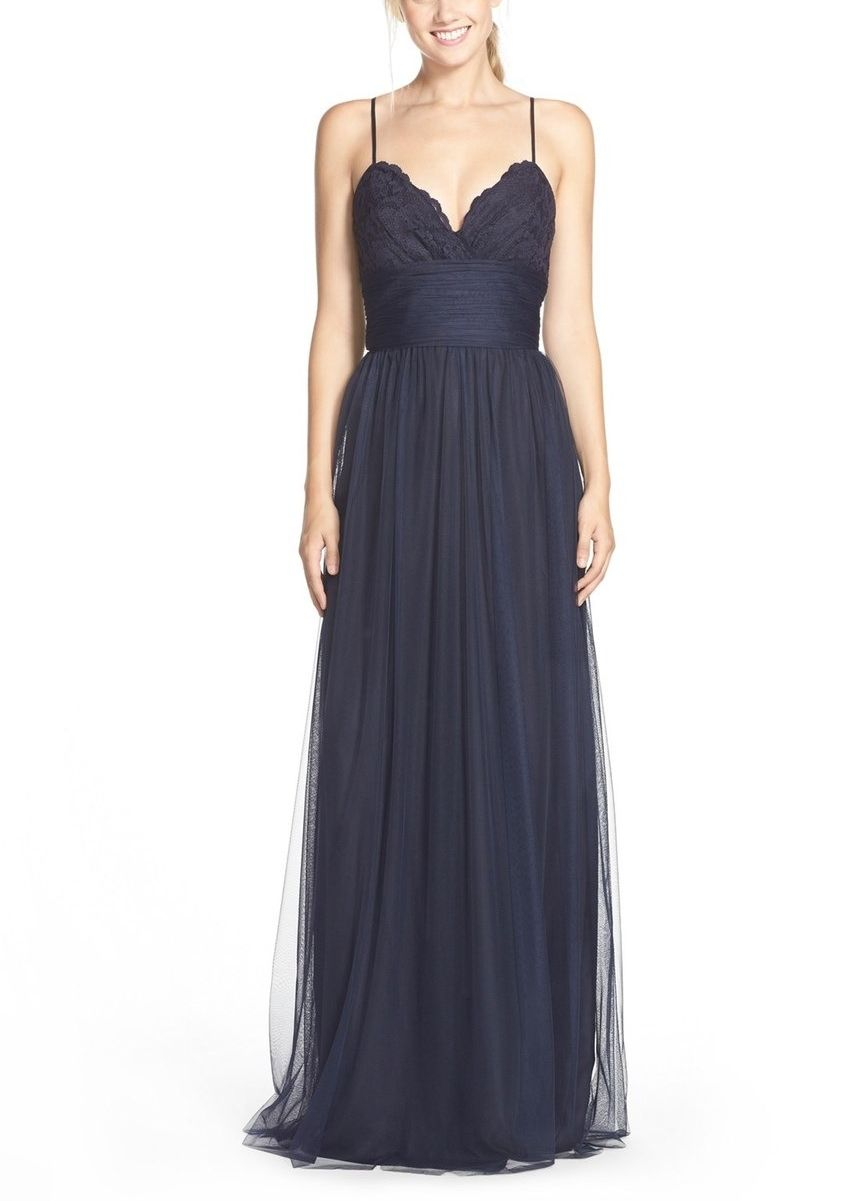 Delicate spaghetti straps and a deep V-neckline accent this lovely ...