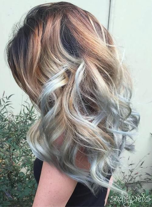 brown blonde hairstyle with light blue highlights