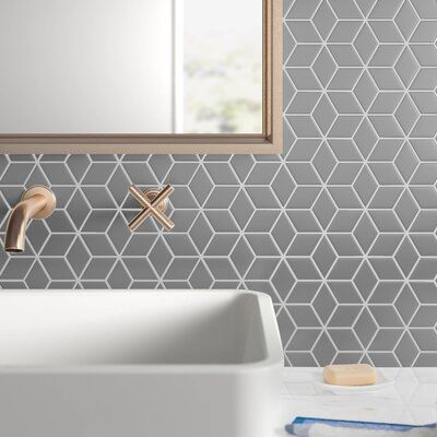 null Real talk: Mosaic tiles like this make creating a fresh look in your space a breeze. Just line up the sheets, apply grout, and you're done. Easy. This sheet is crafted from porcelain with a mesh backing (hello easy mounting), and features a pattern of diamond tiles that work together to create hexagonal shapes. They're rated for heavy traffic, and resist water and mildew, so you can use them everywhere from your bathroom floors to your kitchen walls. Each sheet of tiles measures 10.5'' W x