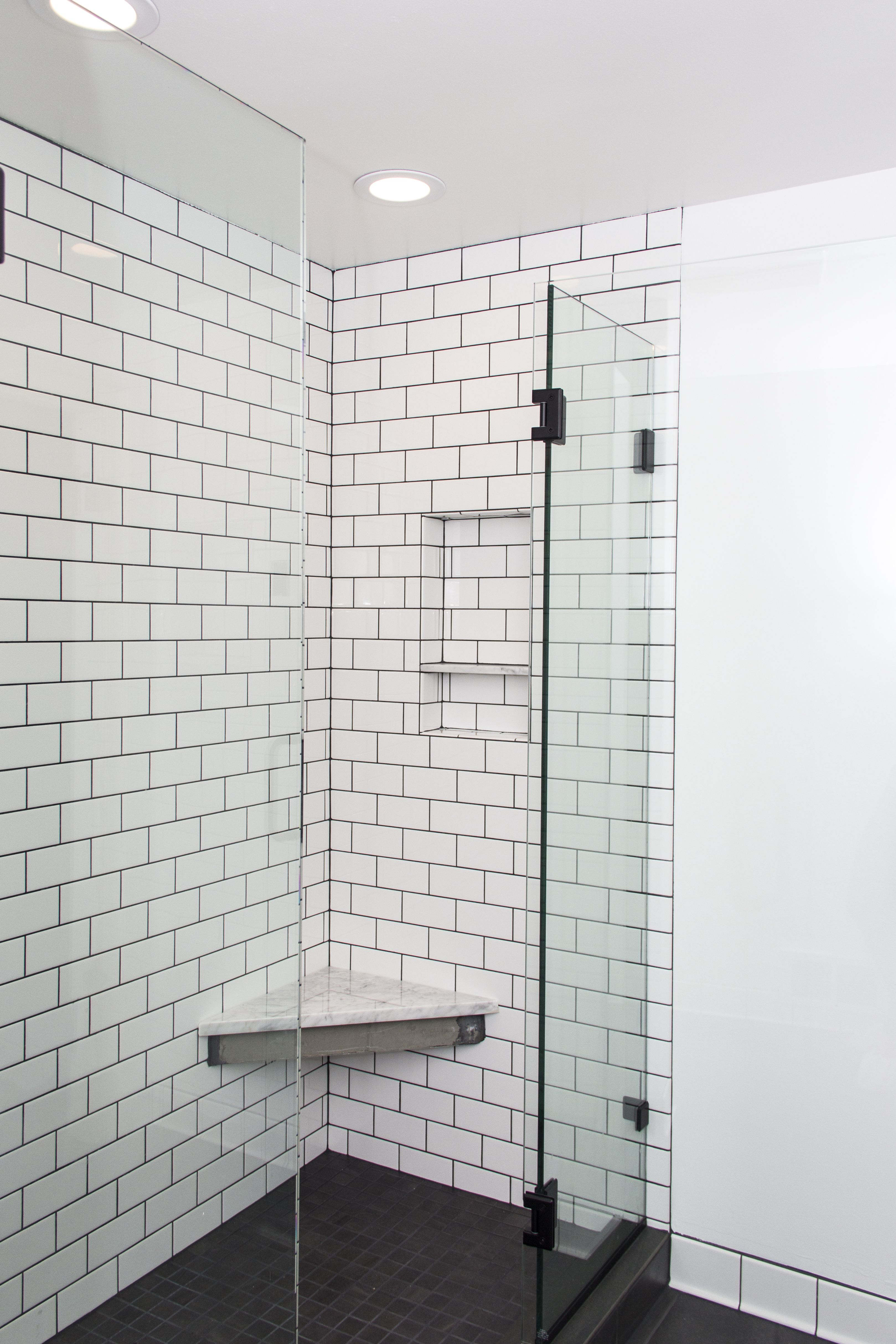 Shower With White Subway Tile And Dark Grout White Subway Tile Shower Shower Tile Subway Tile Showers