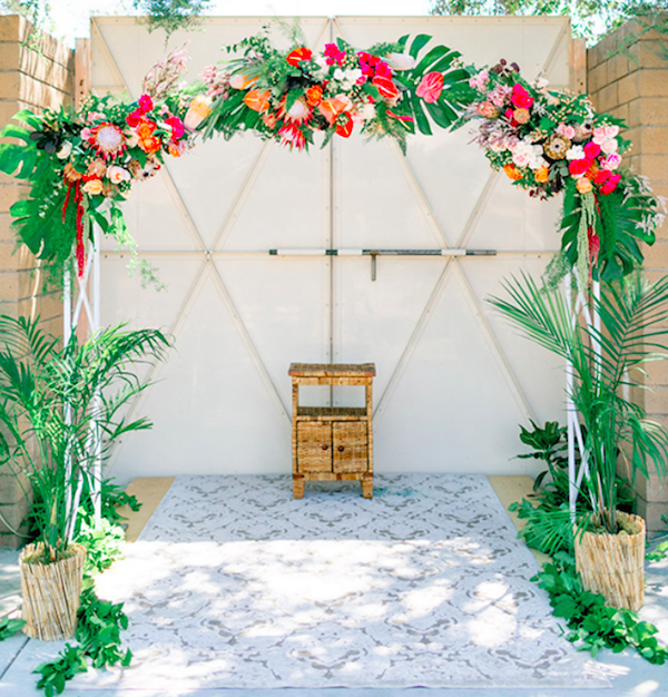 Add Some Flair To Your Ceremony By Decorating A Wedding Arch With Ferns And Tropical Flowers